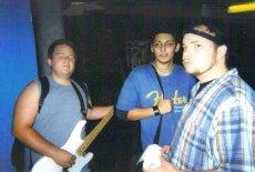 Fr. L: Dylan (Setrip Bassist), Ray, & Derrick. Castle Ultimate Studios. Fall of 2003.