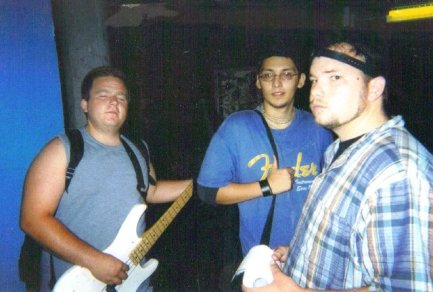 Fr. L: Dylan (Setrip Bassist), Ray, & Derrick. Castle Ultimate Studios. Fall of 2003.